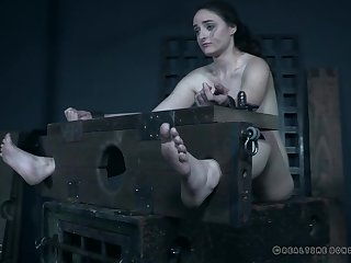 Teen slave girl Luci Lovett has her feet and pussy tortured hardcore