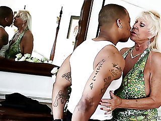 Mature voracious blonde lady sneaks someone else's groom for interracial sex